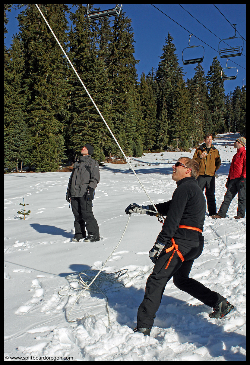 Jim lowering a skier from the chair